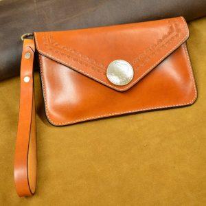 bolso de mano de cuero artesanal